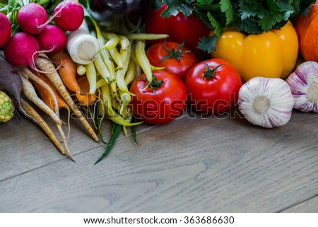 Healthy organic vegetables on a wooden table. Organic food background.