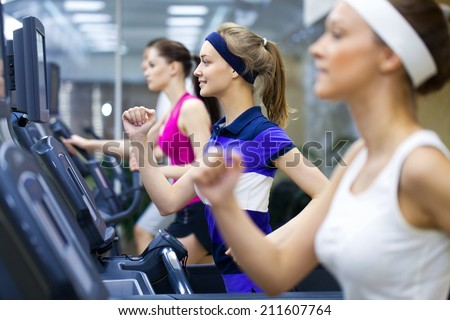 Healthy people  doing fitness exercise  in a sport center - stock photo