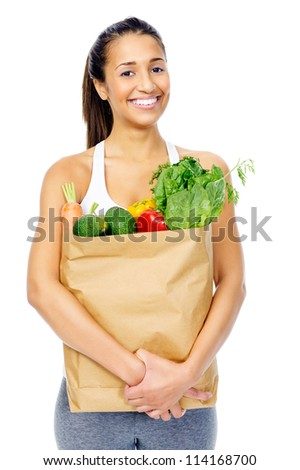 Healthy positive happy woman with paper shopping bag full of organic fruit and vegetables - stock photo