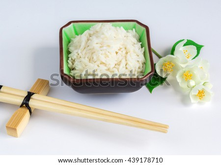 healthy power concept, Eco, a dish with jasmine rice and jasmine flowers on a wooden background - stock photo