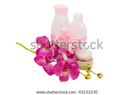 Healthy present: cosmetic with flower orchid, isolated - stock photo