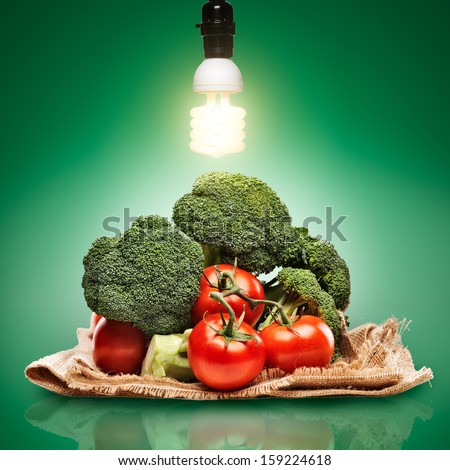 healthy produce concept photo with cfl bulb - stock photo