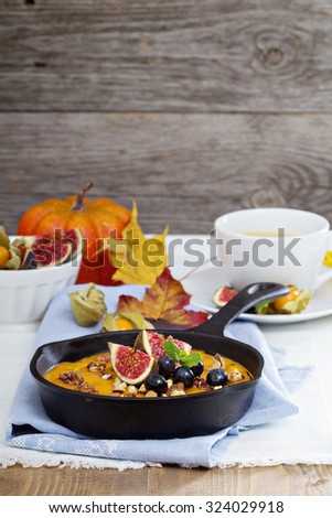 Healthy pumpkin baked oatmeal with banana, nuts, fruits and maple syrup - stock photo