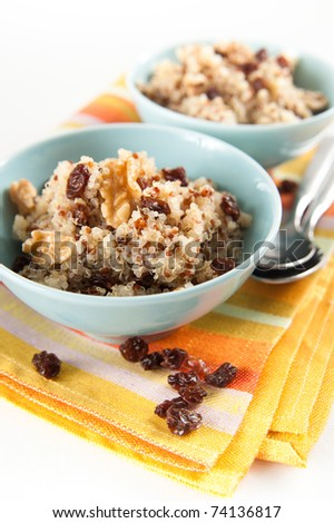 Healthy Quinoa Hot Cereal for Breakfast Served with Raisins and Walnuts - stock photo