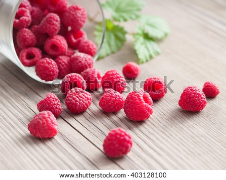 Healthy raspberries in bowl on wooden table.Selective focus, high resolution product. Harvest Concept - stock photo