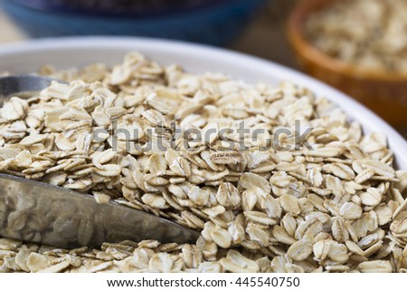 Healthy raw oats with scoop closeup.