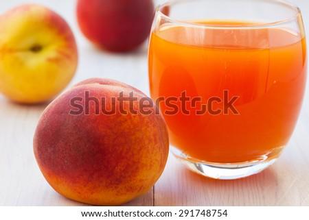 Healthy, refreshing peach nectar juice - stock photo