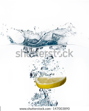 Healthy Refreshment with Lemon and Ice Cube. Splashes - stock photo