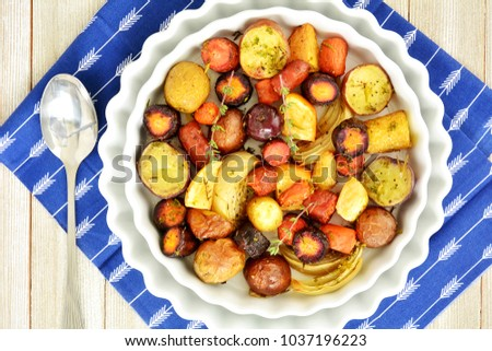Healthy roasted root vegetables from overhead in horizontal format and shot in natural light
