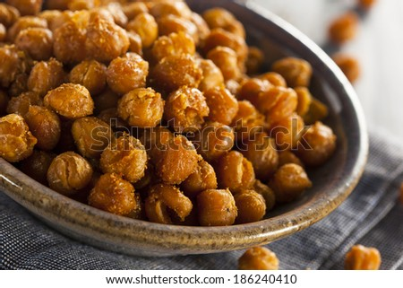 Healthy Roasted Seasoned Chick Peas with Different Spices - stock photo