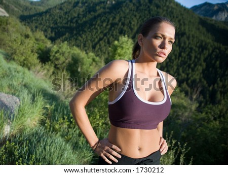 Healthy runner in the mountains - stock photo