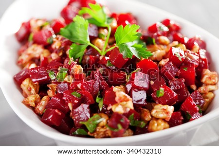 Healthy salad from beet root, walnut and cilantro