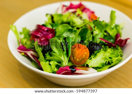 Healthy salad plate on a wooden table