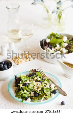 Healthy salad with blue berries and goat cheese - stock photo