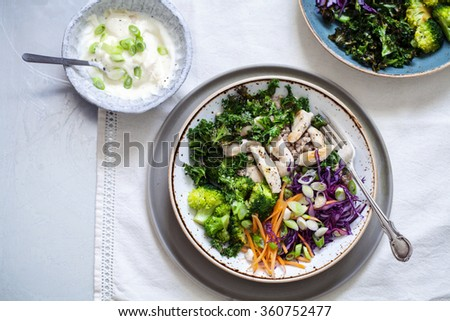 Healthy salad with buckwheat, chicken, broccoli, crispy kale and red cabbage