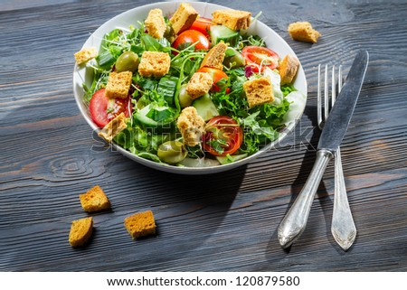 Healthy salad with chicken and fresh vegetables - stock photo