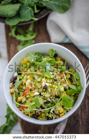 healthy salad with chipotle and cauliflower in white bowl