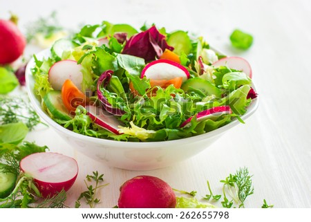 Healthy salad with fresh vegetables  on white background - stock photo