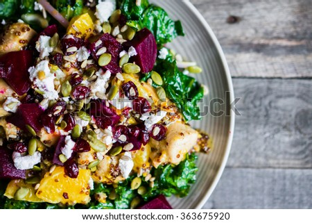 Healthy salad with grilled chicken,kale.beets and goat cheese - stock photo