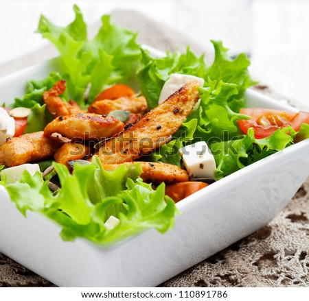 Healthy salad with roasted chicken, tomatoes and feta