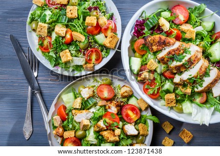 Healthy salads made of hot chicken and fresh - stock photo