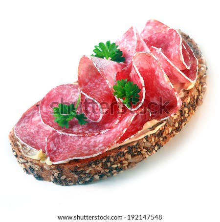 Healthy sandwich with salami and whole grain bread - stock photo
