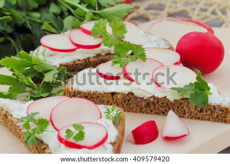 Healthy sandwich with soft cheese, radish and parsley - stock photo