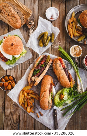 Healthy sandwiches and burger food table. Rustic style . - stock photo
