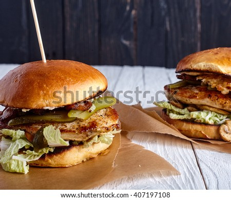 Healthy sandwiches with chicken breast, mushrooms, pickles and other vegies on wood background - stock photo