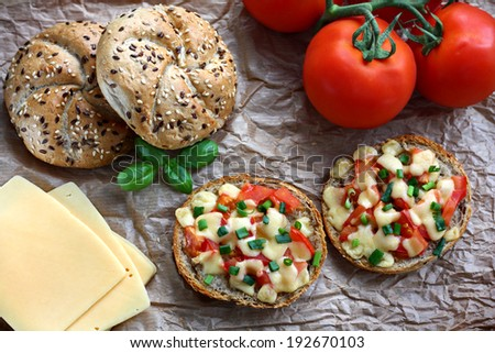 Healthy sandwiches with wholegrain bread rolled, tomatoes and cheese
