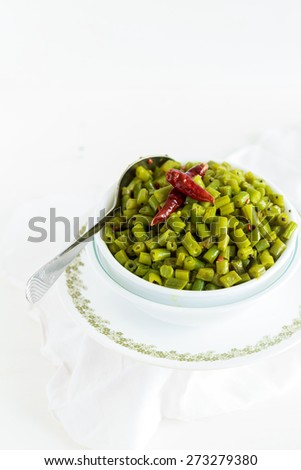 Healthy Sauteed Green Beans  A side dish of Cooked Green beans isolated on a White Background  - stock photo