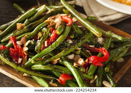 Healthy Sauteed Green Beans with Almonds and Peppers - stock photo