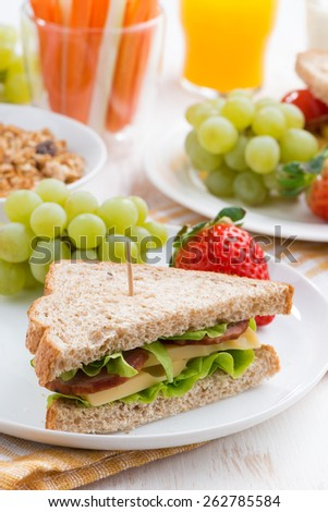 healthy school breakfast with fresh fruits and vegetables, close-up, vertical photo - stock photo