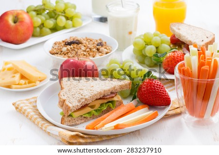 healthy school breakfast with fruits and vegetables, close-up - stock photo