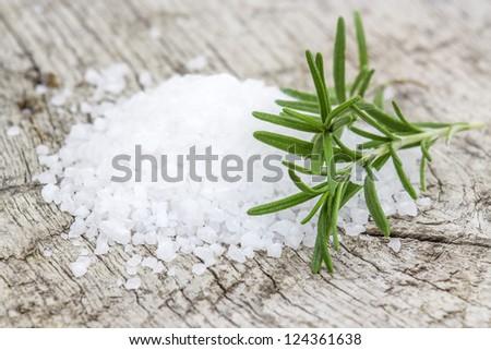 Healthy sea salt and fresh rosemary - stock photo