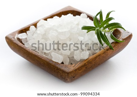 Healthy sea salt in wooden bowl closeup - stock photo