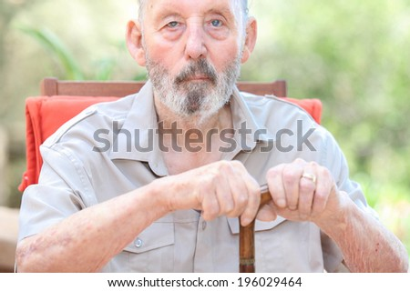 healthy senior in care home, old man with walking stick - stock photo
