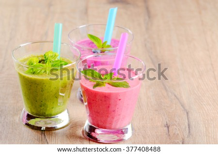 Healthy shakes on wooden table. Smoothie concept