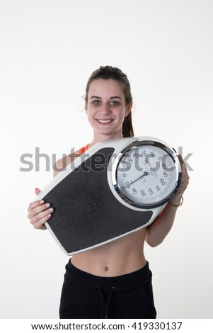 Healthy smiling woman with scales  isolated white background.