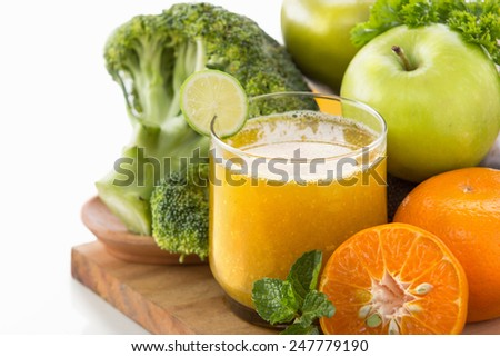 Healthy smoothie with apples, orange and broccoli - stock photo