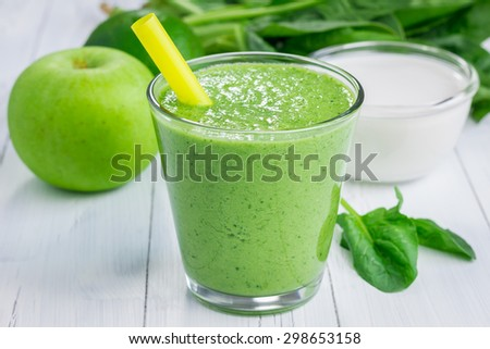 Healthy smoothie with green apple, spinach, lime and coconut milk  - stock photo