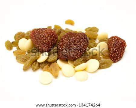 Healthy snack - dried strawberries, green raisins and white chocolate drops - stock photo