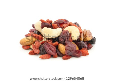 Healthy snack of dried fruits on white background. - stock photo