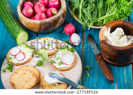 Healthy snackscrackers cottage cheese fresh vegetables stock photo healthy snackscrackers with cottage cheese and fresh vegetables and herbs sisterspd