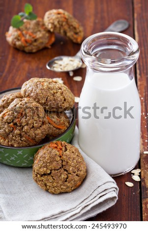 Healthy soft oatmeal carrot cookies with milk - stock photo