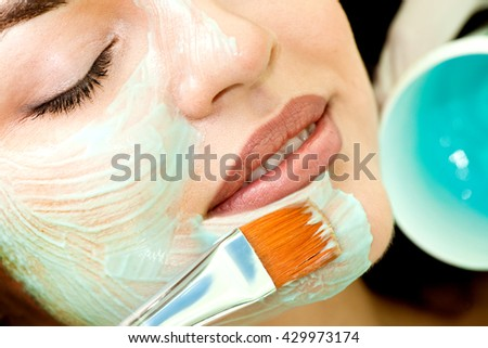 Healthy Spa: Young Relaxing Beauty Having Moistening Mask Applied. Please, view other pictures of this topic here: