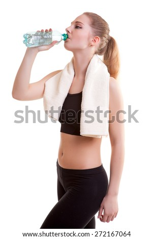 Healthy sport girl drinking water after a sport session. Studio shooting. Isolated on white background - stock photo