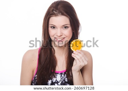 Healthy sporty girl with orange in white background