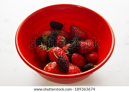 Healthy Strawberry with blackberry mixed in the bowl  - stock photo