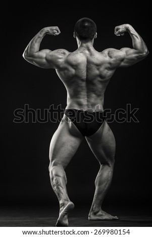 Healthy, strong, muscular man on a black background. - stock photo